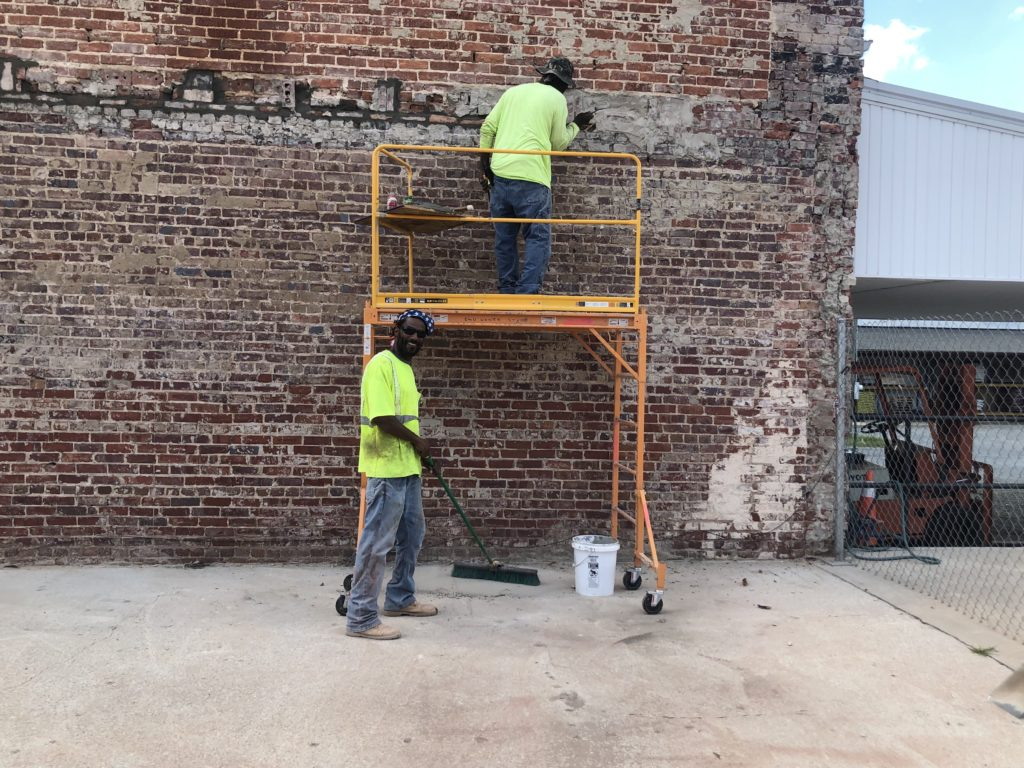 Pictured, Monticello and Jerry doing a fine job replacing our brick at the market square